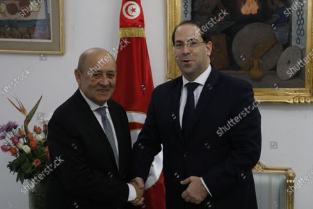 French Foreign Minister Jean-Yves Le Drian (L) and Tunisian Prime Minister Youssef Chahed (R) pose for a photograph in Tunis, Tunisia, 09 January 2020.