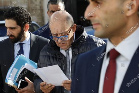 French Foreign Minister Jean-Yves Le Drian (C) arrives to meet with Tunisian Prime Minister Chahed in Tunis, Tunisia, 09 January 2020.