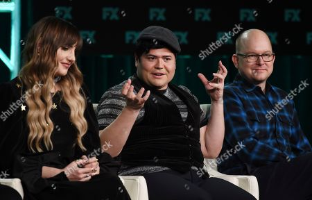"""Harvey Guillen, Natasia Demetriou, Mark Proksch. Harvey Guillen, center, a cast member in the FX series """"What We Do in the Shadows,"""" takes part in a panel discussion with fellow cast members Natasia Demetriou, left, and Mark Proksch at the 2020 FX Networks Television Critics Association Winter Press Tour, in Pasadena, Calif"""