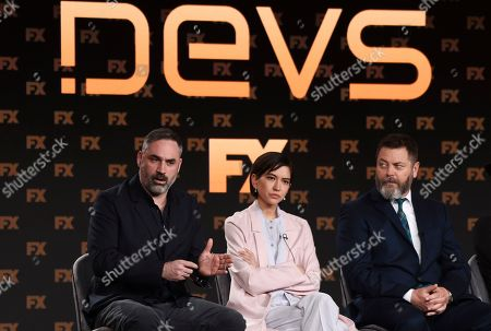 "Alex Garland, Sonoya Mizuno, Nick Offerman. Alex Garland, left, the creator/executive producer/writer/director of the FX on Hulu limited series ""Devs,"" answers a question as cast members Sonoya Mizuno, center, and Nick Offerman look on at the 2020 FX Networks Television Critics Association Winter Press Tour, in Pasadena, Calif"