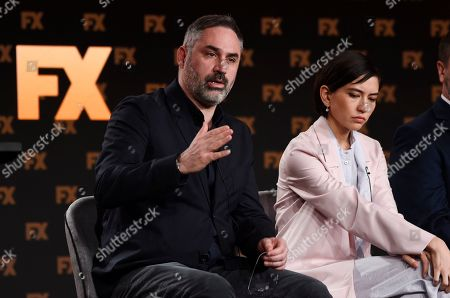 "Alex Garland, Sonoya Mizuno. Alex Garland, left, the creator/executive producer/writer/director of the FX on Hulu limited series ""Devs,"" answers a question as cast member Sonoya Mizuno looks on at the 2020 FX Networks Television Critics Association Winter Press Tour, in Pasadena, Calif"