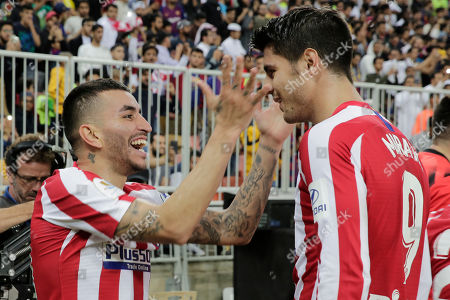 Atletico Madrid's Angel Correa, left, celebrates with Atletico Madrid's Alvaro Morata after scoring his side's third goal during the Spanish Super Cup semifinal soccer match between Barcelona and Atletico Madrid at King Abdullah stadium in Jiddah, Saudi Arabia