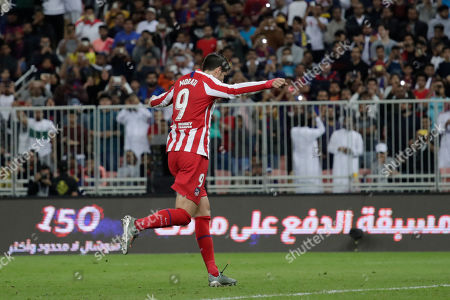 Atletico Madrid's Alvaro Morata celebrates after scoring his side's second goal during the Spanish Super Cup semifinal soccer match between Barcelona and Atletico Madrid at King Abdullah stadium in Jiddah, Saudi Arabia