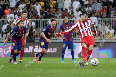 Atletico Madrid's Alvaro Morata, right, scores his side's second goal during the Spanish Super Cup semifinal soccer match between Barcelona and Atletico Madrid at King Abdullah stadium in Jiddah, Saudi Arabia