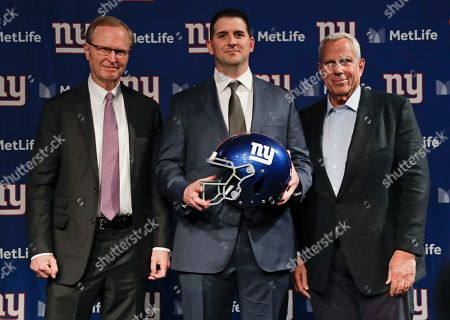 New York Giants new NFL football head coach Joe Judge, center, poses for photographs with New York Giants chairman and executive vice president Steve Tisch, right, and New York Giants CEO John Mara after a news conference, in East Rutherford, N.J