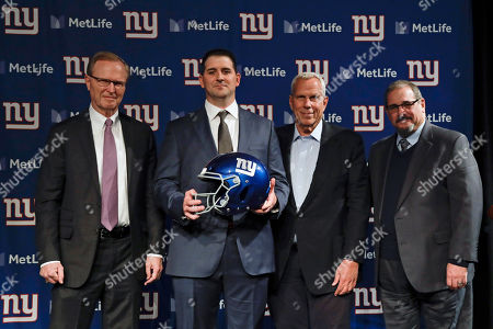 Stock Photo of New York Giants new NFL football head coach Joe Judge, second from left, poses for photographs with New York Giants chairman and executive vice president Steve Tisch, second from right, New York Giants CEO John Mara, left, and New York Giants general manager Dave Gettleman, right, after a news conference, in East Rutherford, N.J