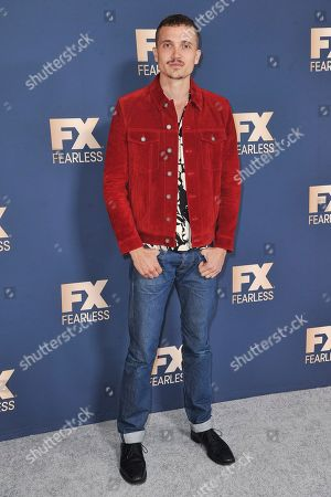 Karl Glusman poses at the the FX portion of theTelevision Critics Association Winter press tour, in Pasadena, Calif