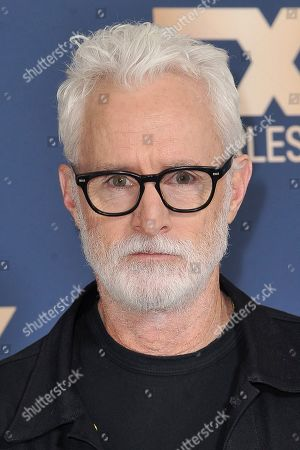 John Slattery poses at the the FX portion of theTelevision Critics Association Winter press tour, in Pasadena, Calif