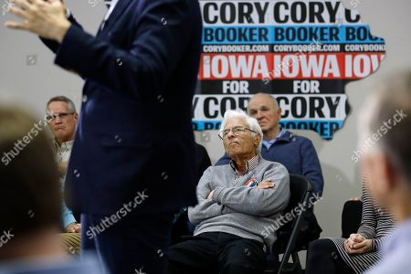 Attendees listen to Democratic presidential candidate, Sen. Cory Booker, D-N.J., speak during a campaign event, in North Liberty, Iowa
