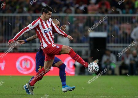 Atletico Madrid's Alvaro Morata controls the ball during the Spanish Super Cup semifinal soccer match between Barcelona and Atletico Madrid at King Abdullah stadium in Jiddah, Saudi Arabia