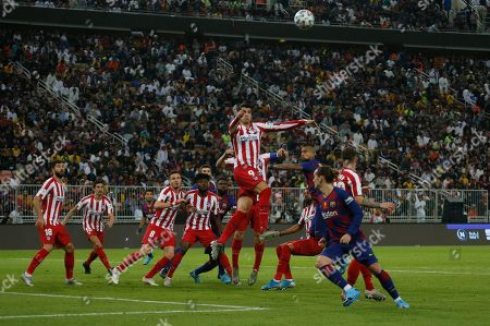 Atletico Madrid's Alvaro Morata, centre top, jumps for the header during the Spanish Super Cup semifinal soccer match between Barcelona and Atletico Madrid at King Abdullah stadium in Jiddah, Saudi Arabia
