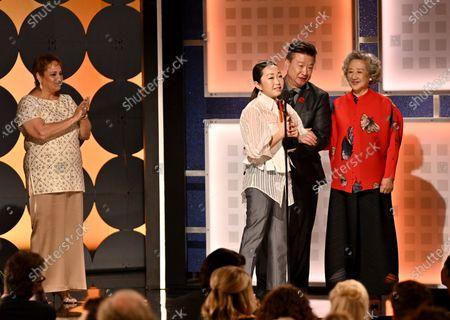 Lulu Wang, Tzi Ma and Zhao Shuzhen - Best Intergenerational Film - The Farewell - presented by Jo Ann Jenkins