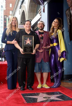 """Nancy O'Dell, Burt Ward, Kevin Smith, Maria Menounos. Burt Ward, who portrayed Dick Grayson and his alter ego Robin in the 1960's TV series """"Batman,"""" second left, poses with TV host Nancy O'Dell, left, filmmaker and comic book enthusiast Kevin Smith and TV personality Maria Menounos, right, at a ceremony honoring Ward with a star on the Hollywood Walk of Fame in Los Angeles on"""