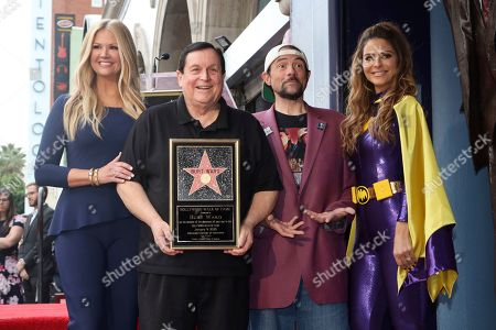 Nancy O'Dell, Burt Ward, Kevin Smith, Maria Menounos. Nancy O'Dell, from left, Burt Ward, Kevin Smith and Maria Menounos pose for a photo following a ceremony honoring Burt Ward with a star at the Hollywood Walk of Fame, in Los Angeles