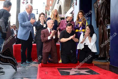 Jeff Zarrinnam, Donelle Dadigan, Mitch O'Farrell, Nancy O'Dell, Burt Ward, Kevin Smith, Maria Menounos, Rana Ghadban. Jeff Zarrinnam, from left, Donelle Dadigan, Mitch O'Farrell, Nancy O'Dell, Burt Ward, Kevin Smith, Maria Menounos and Rana Ghadban unveil a star during a ceremony honoring Burt Ward with a star at the Hollywood Walk of Fame, in Los Angeles