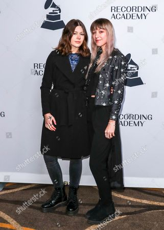 Rebecca Lovell, Megan Lovell, Larkin Poe. Rebecca Lovell, left, and Megan Lovell of Larkin Poe arrive at the 62nd Annual GRAMMY Awards - Nashville Nominee Party at the Hutton Hotel, in Nashville, Tenn