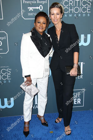 Stock Picture of Wanda Sykes and Alex Sykes