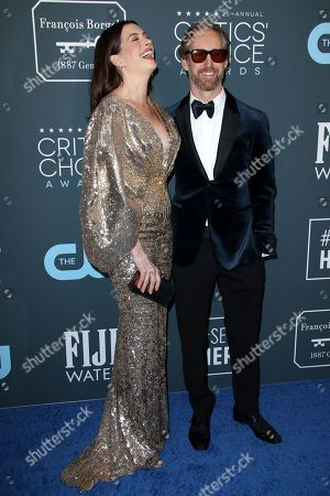 Stock Picture of Anne Hathaway and Adam Shulman
