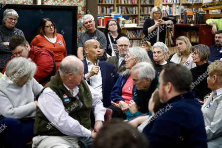 Democratic presidential candidate Sen. Cory Booker, D-N.J., sits in the audience as he speaks during a campaign event, in Mount Vernon, Iowa