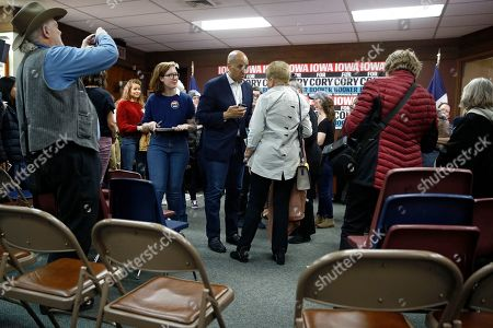 Democratic presidential candidate Sen. Cory Booker, D-N.J., speaks with an attendee after a campaign event, in Mount Vernon, Iowa