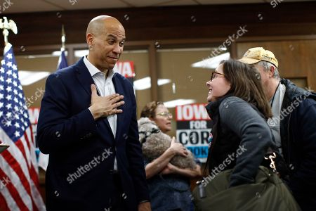Democratic presidential candidate Sen. Cory Booker, D-N.J., speaks with attendees after a campaign event, in Mount Vernon, Iowa
