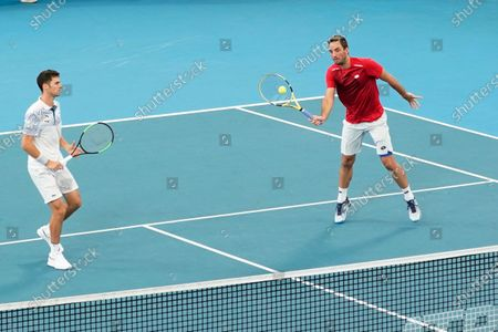 Viktor Troicki (R) and Nikola Cacic (L) of Serbia in action against Peter Polansky and Adil Shamasdin of Canada during day eight of the ATP Cup tennis tournament at Ken Rosewall Arena in Sydney, Australia, 10 January 2020.