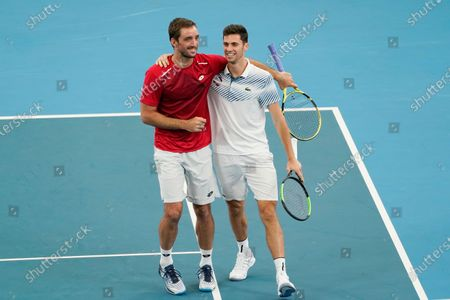 Viktor Troicki (L) and Nikola Cacic (R) of Serbia celebrate their win over Peter Polansky and Adil Shamasdin of Canada during day eight of the ATP Cup tennis tournament at Ken Rosewall Arena in Sydney, Australia, 10 January 2020.