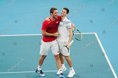 Viktor Troicki (L) and Nikola Cacic (R) of Serbia celebrate their victory over Peter Polansky and Adil Shamasdin of Canada during day eight of the ATP Cup tennis tournament at Ken Rosewall Arena in Sydney, Australia, 10 January 2020.