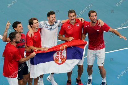 Viktor Troicki (R) and Nikola Cacic (C) of Serbia celebrate their win with team mates over Peter Polansky and Adil Shamasdin of Canada during day eight of the ATP Cup tennis tournament at Ken Rosewall Arena in Sydney, Australia, 10 January 2020.