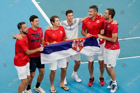 Stock Photo of Viktor Troicki (R) and Nikola Cacic (C-R) of Serbia celebrate their win with team mates over Peter Polansky and Adil Shamasdin of Canada during day eight of the ATP Cup tennis tournament at Ken Rosewall Arena in Sydney, Australia, 10 January 2020.