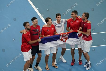 Stock Picture of Viktor Troicki (R) and Nikola Cacic (C-R) of Serbia celebrate their win with team mates over Peter Polansky and Adil Shamasdin of Canada during day eight of the ATP Cup tennis tournament at Ken Rosewall Arena in Sydney, Australia, 10 January 2020.