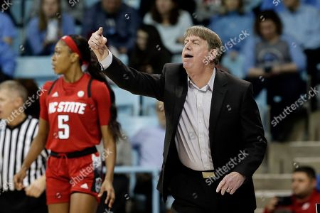 North Carolina State, right, head coach Wes Moore directs his players during the first half of an NCAA college basketball game against North Carolina in Chapel Hill, N.C