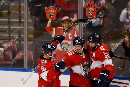 Nick Bjugstad, Noel Acciari, Vincent Trocheck, Aaron Ekblad. Florida Panthers center Noel Acciari (55) celebrates with center Vincent Trocheck (21) and defenseman Aaron Ekblad (5) after scoring during the third period of an NHL hockey game against the Vancouver Canucks, in Sunrise, Fla