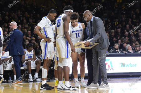 Stock Photo of Memphis Tigers head coach Penny Hardaway draws up a set play in a timeout late in the game during the NCAA Basketball Game between the Memphis Tigers and the Wichita State Shockers at Charles Koch Arena in Wichita,Kansas