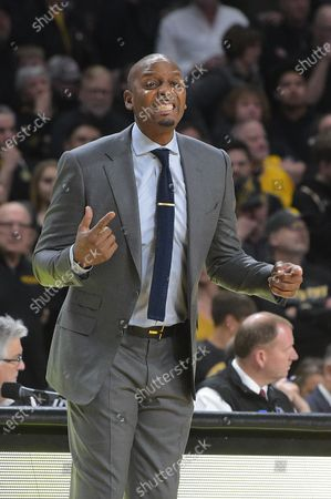 Memphis Tigers head coach Penny Hardaway reacts to the play of his defense in the first half during the NCAA Basketball Game between the Memphis Tigers and the Wichita State Shockers at Charles Koch Arena in Wichita,Kansas