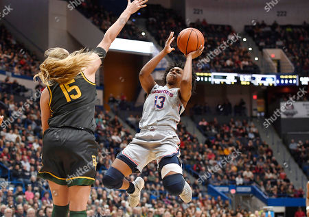 Stock Photo of Lauren Cox, Christyn Williams. Connecticut's Christyn Williams goes up to shoot as Baylor's Lauren Cox defends in the second half of an NCAA college basketball game, in Hartford, Conn