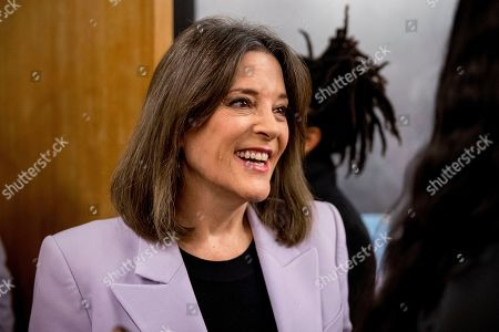 Democratic presidential candidate Marianne Williamson speaks with a guest at a Faith, Politics and the Common Good Forum at Franklin Jr. High School, in Des Moines, Iowa