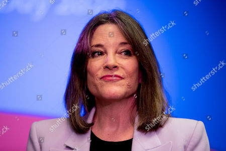 Democratic presidential candidate Marianne Williamson pauses while speaking at a the Faith, Politics and the Common Good Forum at Franklin Jr. High School, in Des Moines, Iowa