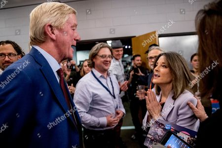 Marianne Williamson, Bill Weld. Republican presidential candidate former Massachusetts Gov. Bill Weld, left, and Democratic presidential candidate Marianne Williamson, right, speak at a Faith, Politics and the Common Good Forum at Franklin Jr. High School, in Des Moines, Iowa