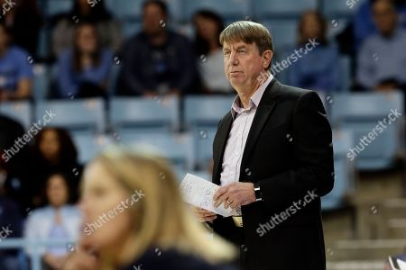 NC State head coach Wes Moore looks on during the first half of an NCAA college basketball game against North Carolina in Chapel Hill, N.C