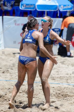 Reka Orsi Toth (R) and Chiara They (L) of Italy celebrate a point during Main Draw Pool E match against Spain on Day 1