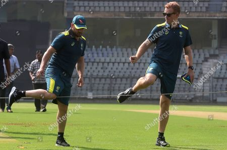 Stock Image of Andrew McDonald, Aaron Finch. Australian cricket captain Aaron Finch, left, along with coach Andrew McDonald walk back after examining the pitch, before addressing a press conference ahead of their 3-match one-day international series against India in Mumbai, India
