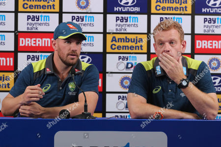 Stock Photo of Aaron Finch, Andrew McDonald. Australian cricket captain Aaron Finch, left, along with coach Andrew McDonald address a press conference ahead of their 3-match one-day international series against India in Mumbai, India