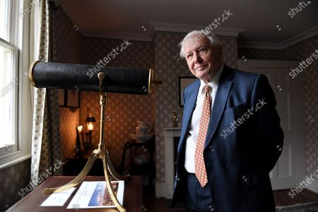 Stock Picture of Sir David Attenborough opens the first exhibition of J.M.W. Turner's original work in the house the great landscape artist designed for himself in Twickenham, London.  He is pictured in a room that had a view of the Thames in Turner's time.