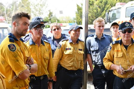 Australian former prime minister Tony Abbott (C) gets a briefing at the Adaminaby Rural Fire Service station, in Adaminaby, New South Wales, Australia, 10 January 2020. Abbott on the day joined volunteers fighting bushfires south of Canberra.