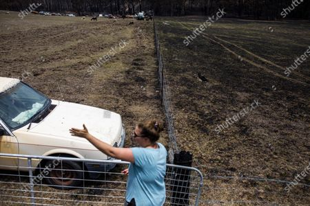 Jessie Collins, 36, at her dad's property in Cobargo, NSW, Australia, 10 January 2020. The fire was stopped in the bottom paddock after her brother ploughed the top paddock as a bushfire approached on New Year's Eve 2019.