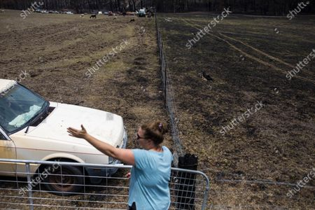 Jessie Collins, 36, at her dad's property in Cobargo, NSW, Australia, 10 January 2020. The fire was stopped in the bottom paddock after her brother ploughed the top paddock as a bushfire approached on New Year's Eve 2019. According to media reports, at least 1,500 homes have been destroyed, 20 people have died and two are missing, and almost five million hectares have been burnt by bushfires this season in New South Wales.
