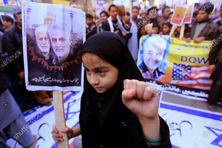 Pakistani Shiite Muslim girl holds pictures of General Qasem Soleimani, the head of Iran's Islamic Revolutionary Guard Corps' elite Quds Force, during a protest against the USA, in Peshawar, Pakistan, 10 January 2020. General Qasem Soleimani, was killed in an airstrike on 03 January, in Baghdad ordered by the United States president, the Pentagon said. General Soleimani was in charge of Iran's foreign policy strategy as the head of the Quds Force, an elite wing of the Islamic Revolutionary Guard Corps, which the US designated as a terror organization. The Quds Force holds sway over a raft of Shia militias across the region, from Lebanon to Syria and Iraq.