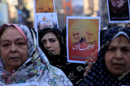 Pakistani Shiite Muslims hold pictures of General Qasem Soleimani, the head of Iran's Islamic Revolutionary Guard Corps' elite Quds Force, during a protest against the USA, in Peshawar, Pakistan, 10 January 2020. General Qasem Soleimani, was killed in an airstrike on 03 January, in Baghdad ordered by the United States president, the Pentagon said. General Soleimani was in charge of Iran's foreign policy strategy as the head of the Quds Force, an elite wing of the Islamic Revolutionary Guard Corps, which the US designated as a terror organization. The Quds Force holds sway over a raft of Shia militias across the region, from Lebanon to Syria and Iraq.