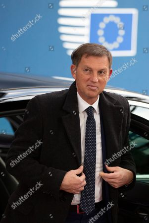 Slovenian Foreign Minister Miro Cerar arrives for a meeting of EU foreign ministers at the Europa building in Brussels, . EU foreign ministers and NATO Secretary General Jens Stoltenberg are gathering in Brussels for an emergency meeting during which they are expected to reiterate their support for the nuclear deal brokered with Iran